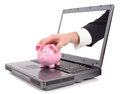 Online banking theft over the internet concept with a hand poping out of the screen to steal a piggy bank isolated on a white Stock Image