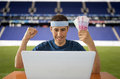 Online betting gaining euros in stadium man and making a lot of Stock Photo