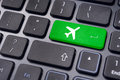 Online booking of flight ticket with plane sign on keyboard a to illustrate or purchase or business travel concepts Stock Image