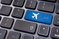 Online booking of flight ticket with plane sign on keyboard a to illustrate or purchase or business travel concepts Royalty Free Stock Photo