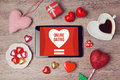 Online dating concept with digital tablet mock up and heart chocolates valentine s day romantic celebration view from above Stock Photos