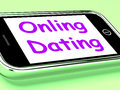 Online dating on phone shows romancing and web love Stock Photos