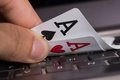 Online gambling concept aces on computer keyboard Royalty Free Stock Images