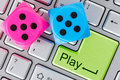 Online gaming concept red and blue dice on the computer keyboard Royalty Free Stock Photography