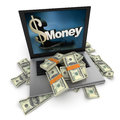 Online money dollars a portable computer with written on the screen with the keyboard cover in hundred dollar bills Royalty Free Stock Images