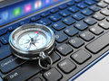 Online navigation. Compass on laptop keyboard. Stock Photography