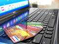 Online purchase credit card on laptop keyboard d Stock Photography