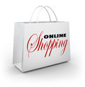 Online shopping bag e commerce web store the words on a white to illustrate buying goods and services on websites or based stores Stock Photography