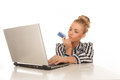 Online shopping blonde girl with card on laptop Stock Image
