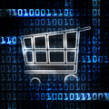 Online shopping cart and binary code Royalty Free Stock Photography