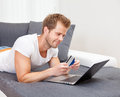Online shopping from the comfort of your home doing Royalty Free Stock Images