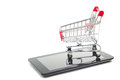 Online shopping concept - Empty Shopping Cart, laptop and tablet pc, smartphone  on white background. Copy space Royalty Free Stock Photo