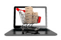 Online shopping concept shopping cart with boxes over laptop on a white background Stock Images