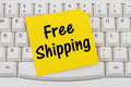 Online shopping with Free Shipping, computer keyboard and sticky Royalty Free Stock Photo
