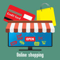 Online shopping. TV screen or monitor, a credit card and shoppin Royalty Free Stock Photo