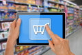Stock Photo Online Supermarket Shopping Tablet with Hands