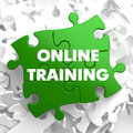 Online training on green puzzle white background Stock Photography