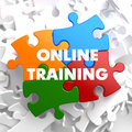 Online training on multicolor puzzle white background Stock Images