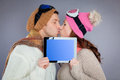 Online winter sport travel tablet couple kissing for Royalty Free Stock Photography