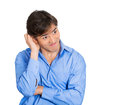 Oopsie closeup portrait of young adult man who is bothered by mistakes he has made looking away nervous isolated on white Stock Photos