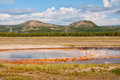 Opal pool and twin buttes with in background yellowstone national park wyoming Royalty Free Stock Image