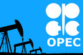 Opec logo and silhouette industrial oil pump jack on rustic blue background Stock Photography