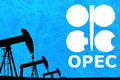 Opec logo and silhouette industrial oil pump jack on rustic blue background Royalty Free Stock Images