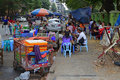 Open air hawker foodstall by the road side with tables and chairs Royalty Free Stock Photo