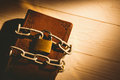 Open bible chained with lock on wooden table Royalty Free Stock Photo