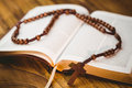 Open bible with rosary beads Royalty Free Stock Photo
