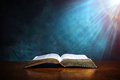 Open Bible on a wood table Royalty Free Stock Photo