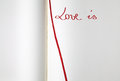 Open blank exercise book love is with red bookmark Royalty Free Stock Image