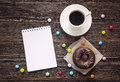 Open blank notebook, cup of coffee and a chocolate donut on a wo Royalty Free Stock Photo