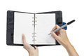 Open blank page note book and hand