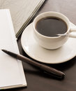 Open a blank white notebook pen and cup of coffee on the desk Stock Photo