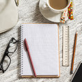 Open a blank white notebook, pen, women's bag, ruler, pencil and cup of coffee Royalty Free Stock Photo
