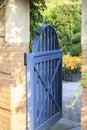 Open Blue Garden Gate Leading into Botanic Garden Area Royalty Free Stock Photo