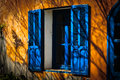 Open blue window shade of flower near Royalty Free Stock Images