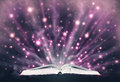 Open book emitting sparkling light on abstract wormhole background concept for future or spiritual meaning Stock Photo