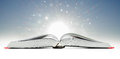 Open book emitting sparkling light Royalty Free Stock Photo