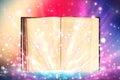 Open book emitting sparkling light