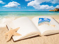 Open book with empty page on summer beach for copy space Stock Image