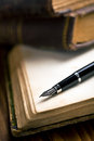 Open book with fountain pen Royalty Free Stock Photo