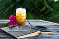 Open book with ice tea outside Royalty Free Stock Photo