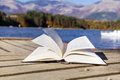 Open book on a Mountain lake Royalty Free Stock Photo