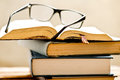 Open book with reading glasses Royalty Free Stock Photo