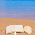 Open book on a sea shore leisure concept Stock Image
