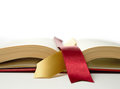 Open book stock photograph of legal concept old with legal ribbon ties on a white surface copy space Stock Photos