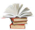 Open book on top of stack of books isolated white background Royalty Free Stock Photo