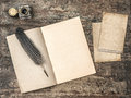 Open book, vintage writing tools feather pen and inkwell Royalty Free Stock Photo